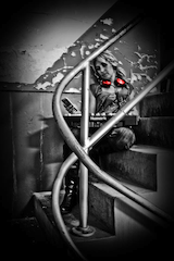 Female-DJ-Black and White-Stairs-Red headphones