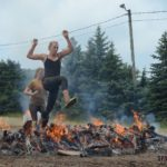 Deeay Shelly jumping over fire at the Spartan Race 2013