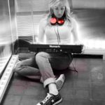 Female DJ with Red Headphones